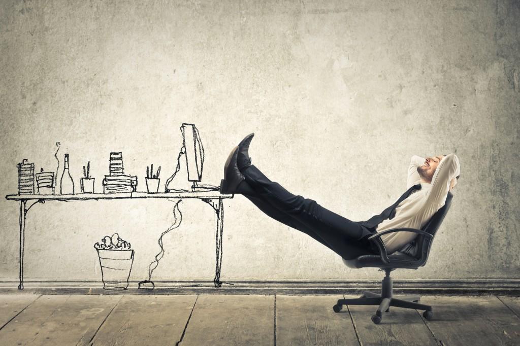 bigstock-young-businessman-relaxes-sitt-45342265