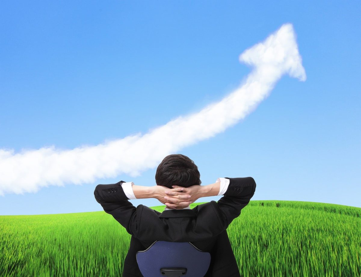 Business Man Sit On Chair And Watch Growth Cloud