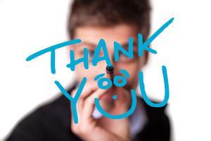 Man writing Thank You