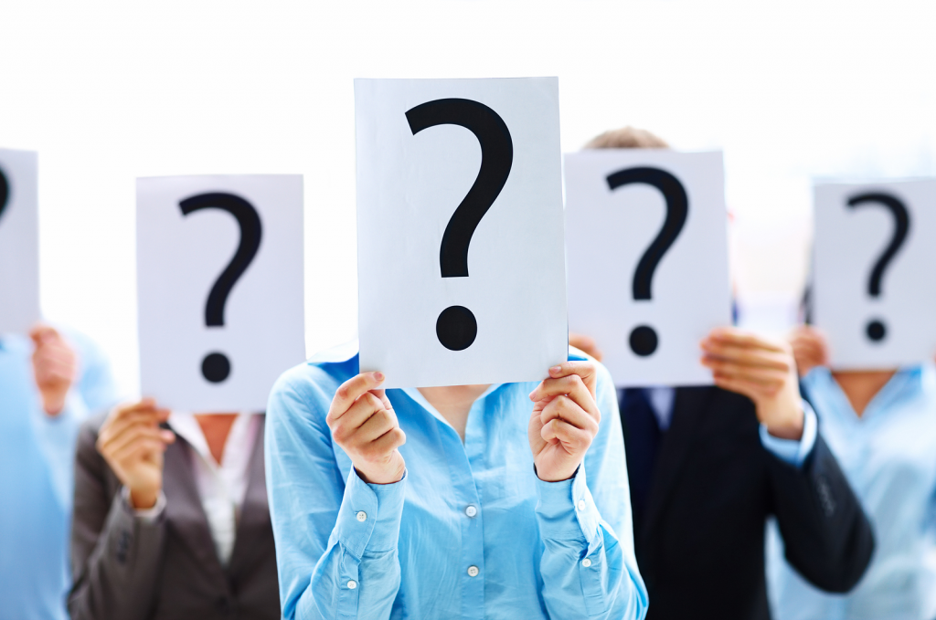 People with Question Mark Signs