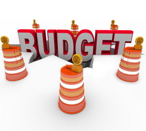 bigstock_The_word_budget_falling_into_a_22255019