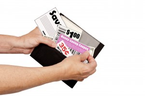 bigstock-Pulling-Coupons-Out-of-Wallet-38342842