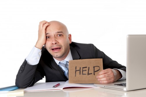 Bald Latin Business Man Over Worked Holding A Help Sign
