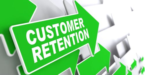 Customer Retention on Direction Sign - Green Arrow on a Grey Background.