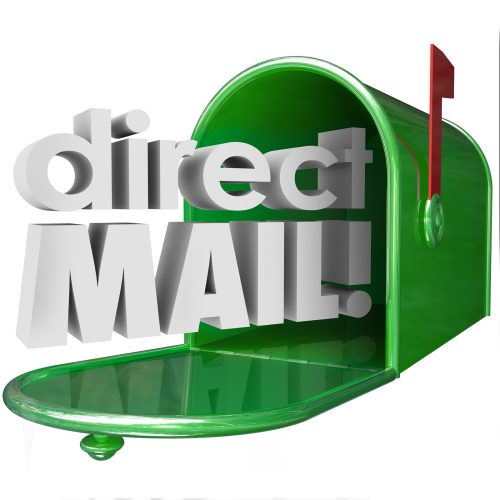 Direct Mail words in 3d letters coming out of a green metal mailbox advertising