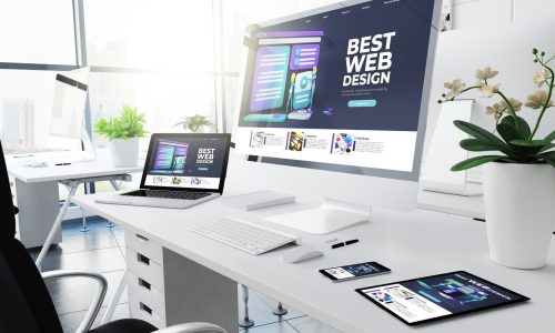 computers with business website designs on them