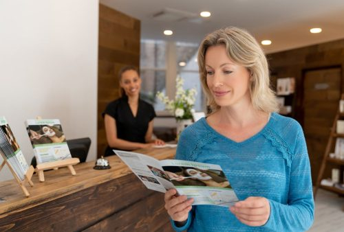 woman looking at a business brochure